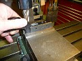 I use a parallel to set the trigger guard up level on the milling machine vise.