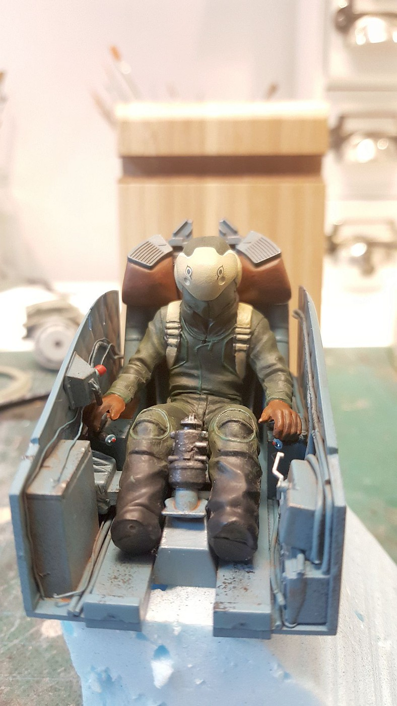 figure painted mounted in cockpit